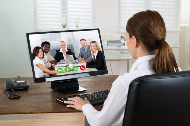 Businesswoman Videochatting With Colleagues On Computer