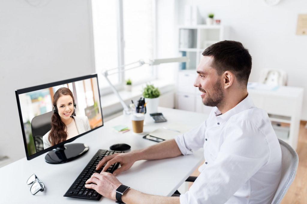 business, people and technology concept - businessman having video call with customer service operator or partner on pc computer at office