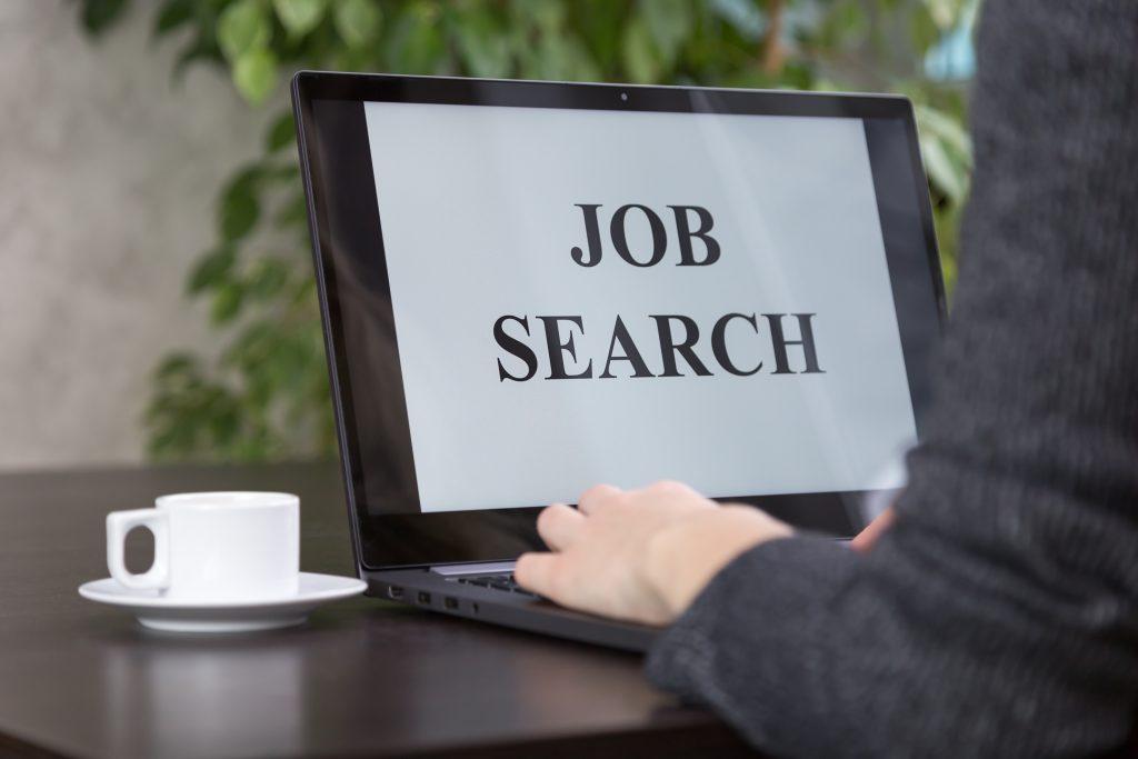a-girl-looking-for-a-job-on-the-internet-ACJTZUA